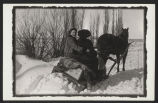 Hannah and Alice Nelson on a sled
